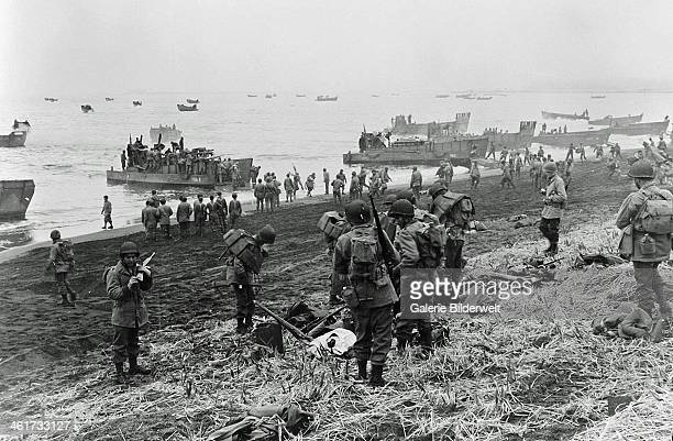 Landing boats pouring soldiers and their equipment onto the beach at Massacre Bay Attu Island 11th May 1943 The American and Canadian troops took...