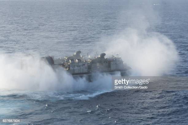 A landing craft air cushion departs the well deck of the amphibious assault ship USS Bonhomme Richard East China Sea January 26 2012 Image courtesy...