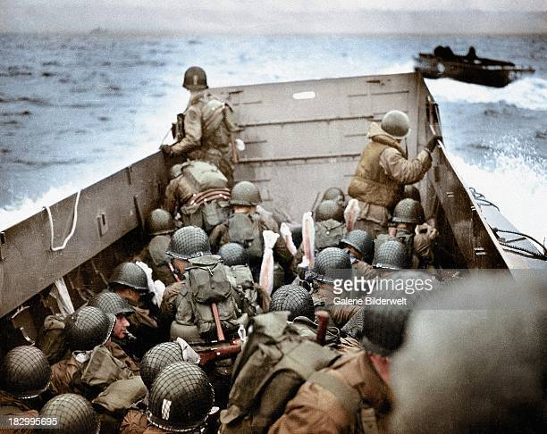 Landing Craft, Vehicle, Personnel is approaching Omaha Beach, Normandy, France, 6th June 1944. To the right is another LCVP. The soldiers are...