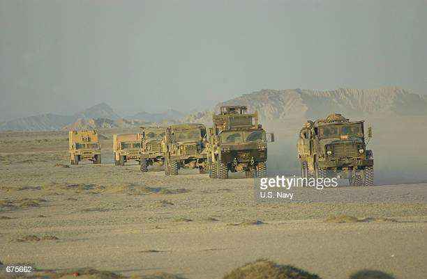 Landing Force Support Party made up of 26th Marine Expeditionary Unit Marines, head toward an undisclosed location in support of Operation Enduring...