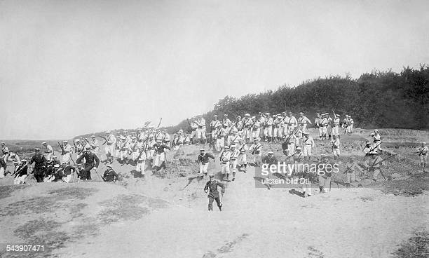 Landing operation crew of the SMS 'Barbarossa' is charging the dunes in the direction of the camera 1901 Photographer A Renard Published by 'Berliner...