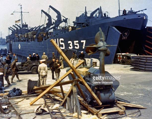 Landing Ship Tank loading an ambulance at Portland Harbour Dorset before the DDay landings 5th June 1944 It will soon depart to participate in the...