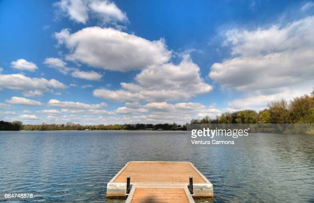 landing stage in the lake wolfssee in duisburg, germany - beschaulichkeit stock pictures, royalty-free photos & images