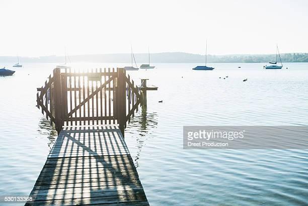 Landing stage wooden lake water sunset