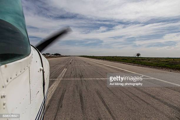 Landing strip view from airplane during takeoff