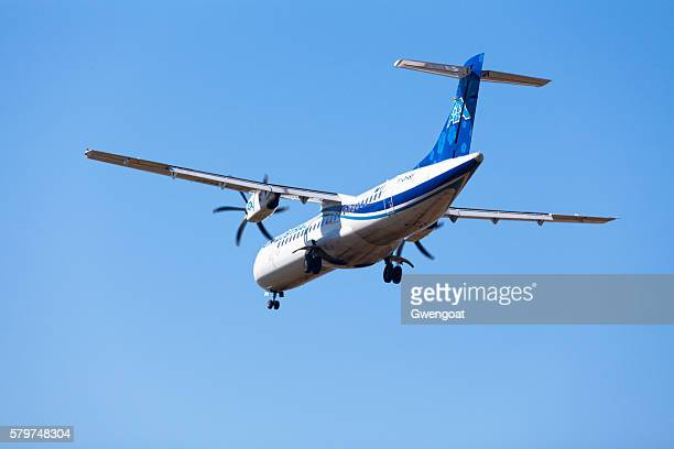 atr72 landing to the airport - gwengoat stock pictures, royalty-free photos & images