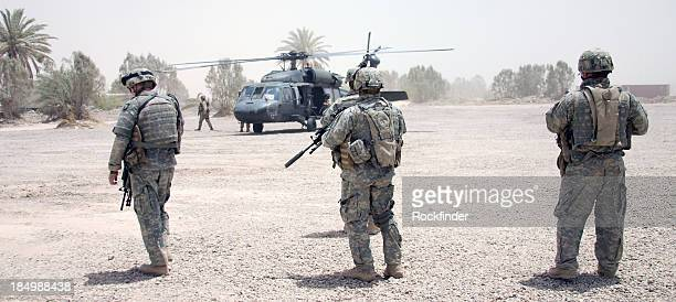 landing zone security - military helicopter stock photos and pictures