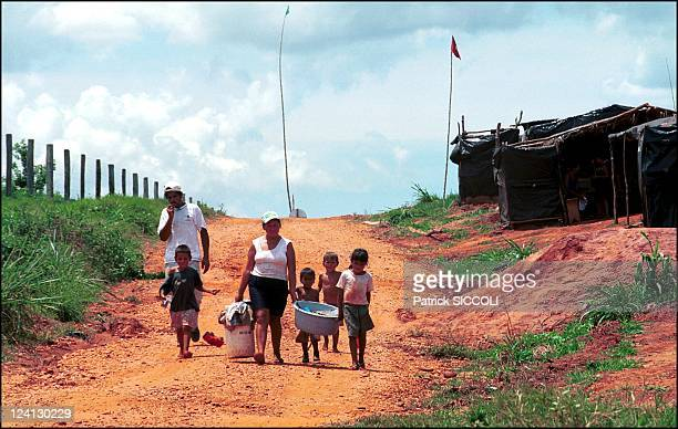 Landless workers movement In Brazil On November 28 2000 After hand washing clothes one kilometer from home