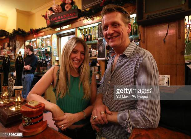 Landlord of the Coach And Horses in Soho London Alastair Choat and his daughter Hollie hosting London's first nudist pub singalong