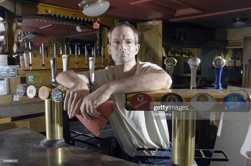 Landlord of the Plough pub, Andrew Rogerson, poses inside hi : News Photo