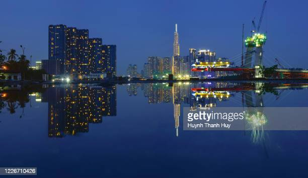 landmark 81 building by night - saigon river stock pictures, royalty-free photos & images