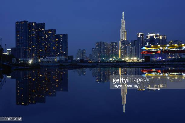 landmark 81 building by reflection night - saigon river stock pictures, royalty-free photos & images