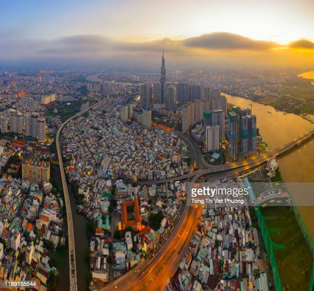 landmark 81 is a super-tall skyscraper, villas, garden view and luxury apartments of vinhomes central park in ho chi minh city, vietnam - saigon river stock pictures, royalty-free photos & images