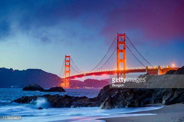 landmark golden gate bridge in san francisco at dusk - golden gate bridge stock pictures, royalty-free photos & images