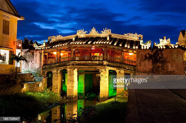 landmark japanese bridge by night in hoi an, vietnam - hoi an stock pictures, royalty-free photos & images