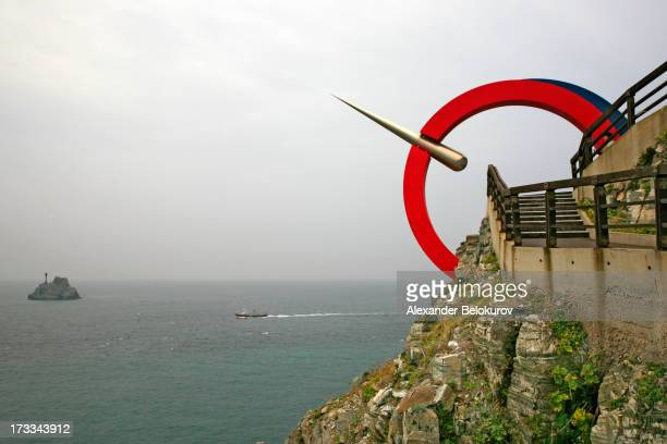 CONTENT] Landmark monument in Taejongdae Resort park Busan South Korea with views over the cliffs sea and small island A boat is passing by on a day...