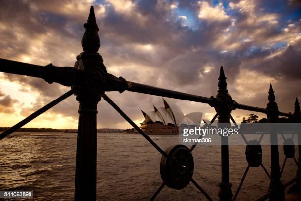 landmark of Sydney with Sydney oepra house harbor bridge in twilight time and ferry and building city near the rocks area sydney