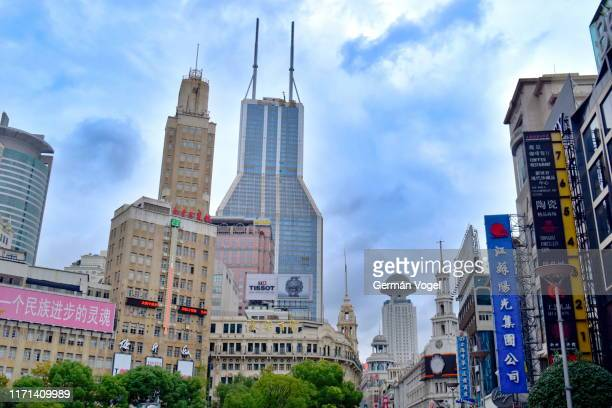 landmark shanghai old and new architecture along shopping street east nanjing road, china - nanjing road stock pictures, royalty-free photos & images