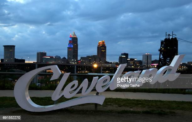 Landmark sign over Cleveland skyline