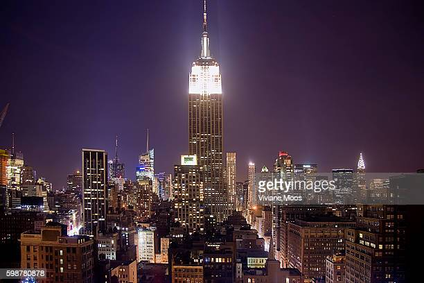 Landmarks like the Empire State Building and the Chrysler building in New York City with all the lights on a few minutes before Earth Hour For the...