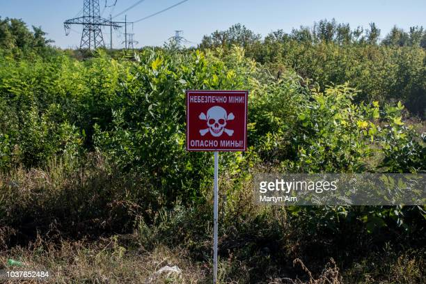 A landmine warning sign at a Ukraine Army controlled checkpoint between Ukrainian government and proRussian separatist governed territory on...