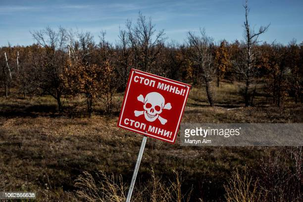 A landmine warning sign stands in front of forested land on the border of the LNR and Ukrainian government controlled territory on November 2 2018 in...