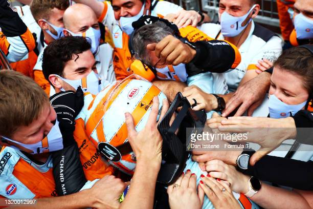 Lando Norris of Great Britain and McLaren celebrates with his team after finishing third in the F1 Grand Prix of Monaco at Circuit de Monaco on May...