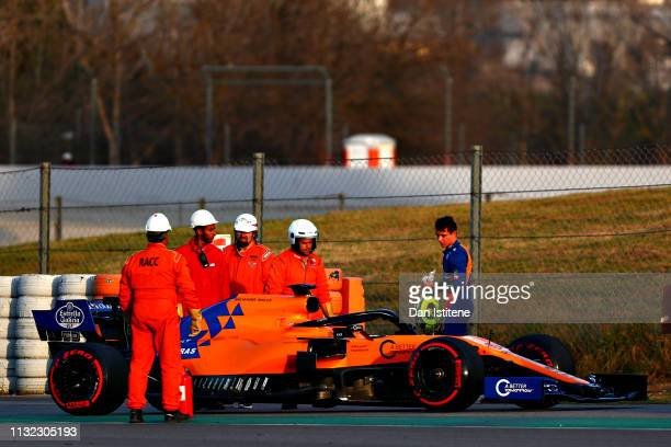Lando Norris of Great Britain and McLaren F1 looks on after stopping on track during day one of F1 Winter Testing at Circuit de Catalunya on February...