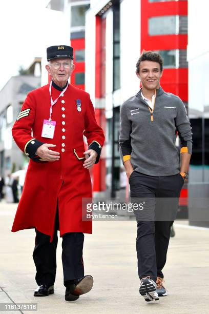 Lando Norris of Great Britain and McLaren F1 walks in the Paddock during previews ahead of the F1 Grand Prix of Great Britain at Silverstone on July...