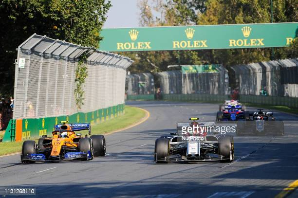 Lando Norris of Great Britain drives the McLaren F1 Team MCL34 alongside Antonio Giovinazzi of Italy who drives the Alfa Romeo Racing C38 during the...