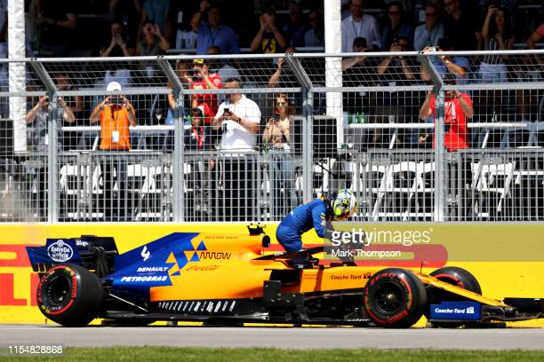 Lando Norris of Great Britain driving the McLaren F1 Team MCL34 Renault climbs from his car after retiring during the F1 Grand Prix of Canada at...