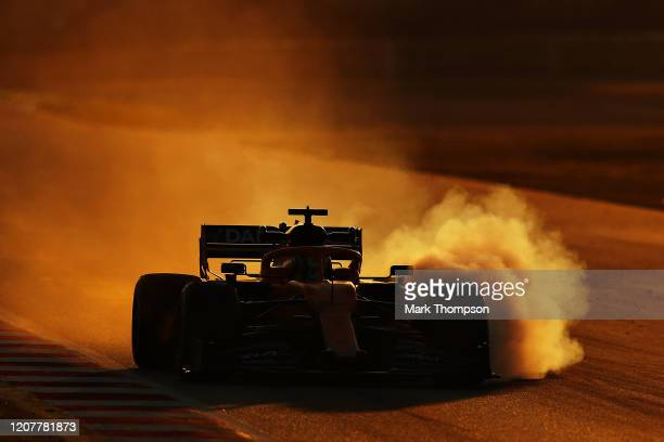 Lando Norris of Great Britain driving the McLaren F1 Team MCL35 Renault locks a wheel under braking during day three of F1 Winter Testing at Circuit...