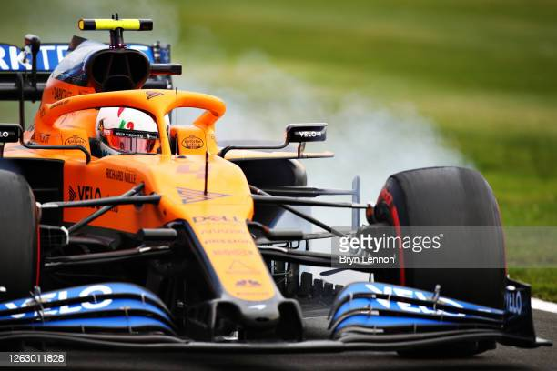 Lando Norris of Great Britain driving the McLaren F1 Team MCL35 Renault locks a wheel under braking during practice for the F1 Grand Prix of Great...