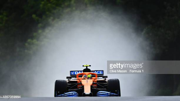 Lando Norris of Great Britain driving the McLaren F1 Team MCL35 Renault on the way to the grid before the Formula One Grand Prix of Hungary at...