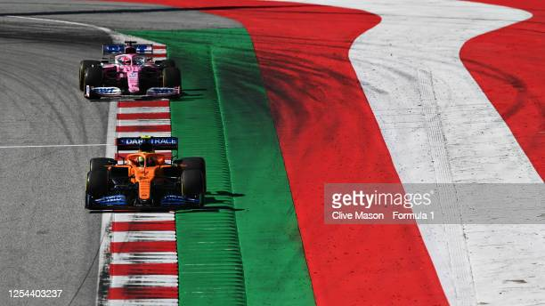 Lando Norris of Great Britain driving the McLaren F1 Team MCL35 Renault leads Sergio Perez of Mexico driving the Racing Point RP20 Mercedes on track...