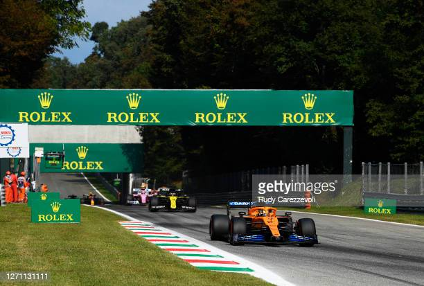 Lando Norris of Great Britain driving the McLaren F1 Team MCL35 Renault leads Daniel Ricciardo of Australia driving the Renault Sport Formula One...