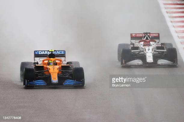 Lando Norris of Great Britain driving the McLaren F1 Team MCL35M Mercedes and Kimi Raikkonen of Finland driving the Alfa Romeo Racing C41 Ferrari...