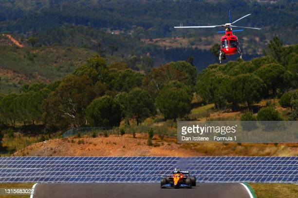 Lando Norris of Great Britain driving the McLaren F1 Team MCL35M Mercedes as the TV helicopter flies overhead during qualifying for the F1 Grand Prix...