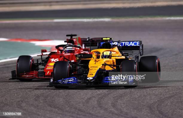 Lando Norris of Great Britain driving the McLaren F1 Team MCL35M Mercedes leads Charles Leclerc of Monaco driving the Scuderia Ferrari SF21 during...