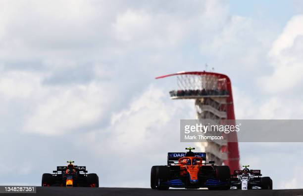 Lando Norris of Great Britain driving the McLaren F1 Team MCL35M Mercedes, Sergio Perez of Mexico driving the Red Bull Racing RB16B Honda and Antonio...
