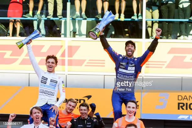 Lando Norris of McLaren and Great Britain and Daniel Ricciardo of Australia and McLaren celebrate a finishing 1-2 during the F1 Grand Prix of Italy...