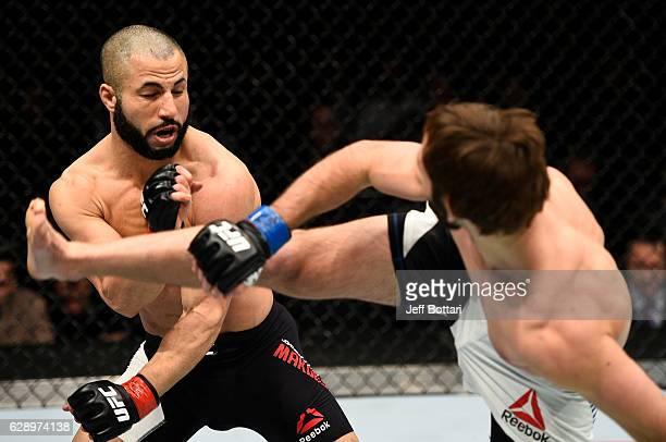 Lando Vannata kicks John Makdessi in their lightweight bout during the UFC 206 event inside the Air Canada Centre on December 10, 2016 in Toronto,...