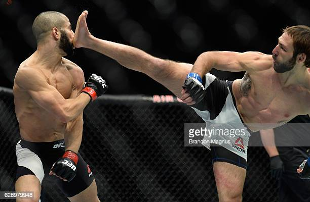 Lando Vannata kicks John Makdessi of Canada in their lightweight bout during the UFC 206 event inside the Air Canada Centre on December 10, 2016 in...