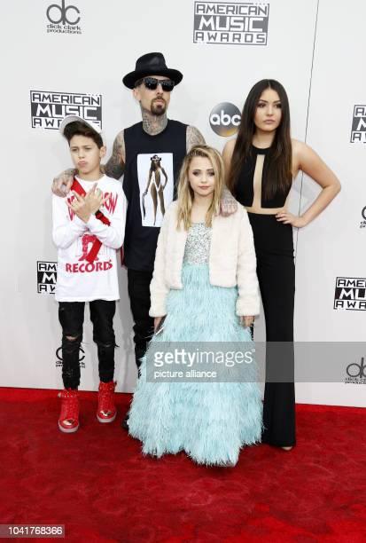 Landon Asher Barker recording artist Travis Barker Alabama Luella Barker and Atiana de la Hoya attend the American Music Awards AMAs at Microsoft...