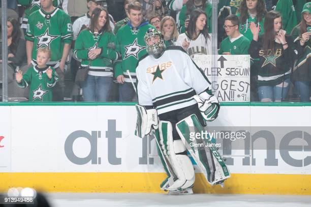 Landon Bow of the Dallas Stars skates during warm ups wearing a 1993 era jersey as part of 'Retro Night' before a game against the Minnesota Wild at...