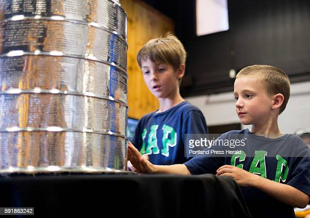 Landon Brown of Auburn gets his chance to touch the Stanley Cup after having his photo taken with it at the Biddeford Arena