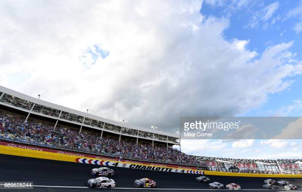 Landon Cassill driver of the CSX Play It Safe Ford and Gray Gaulding driver of the Bubba Burger Toyota lead a pack of cars during the Monster Energy...