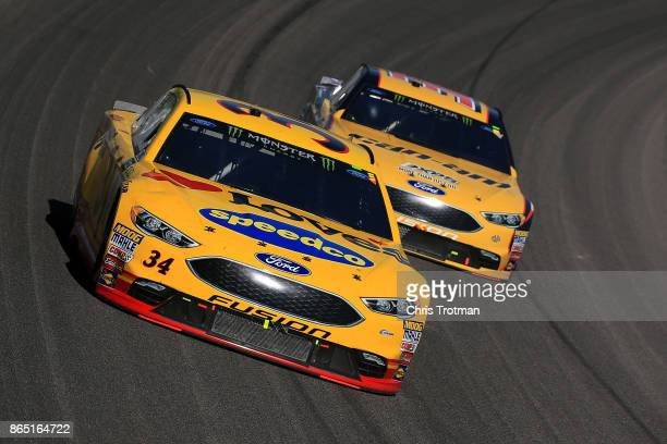 Landon Cassill driver of the Love's Travel Stops Ford leads Matt DiBenedetto driver of the CanAm/Kappa Ford during the Monster Energy NASCAR Cup...