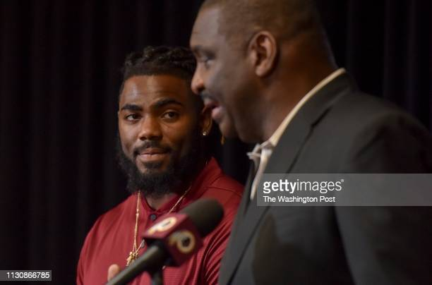 Landon Collins a threetime Pro Bowl selection is introduced by Doug Williams Redskins' Senior Vice President of Player Personnel at Redskins Park on...