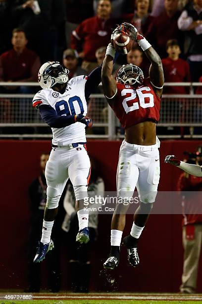 Landon Collins of the Alabama Crimson Tide deflects a pass intended for Marcus Davis of the Auburn Tigers in the second quarter during the Iron Bowl...